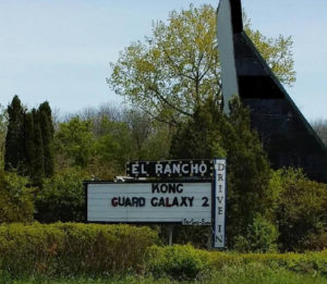 El Rancho Drive-In marquee with screen in background