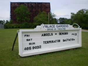 Palace Gardens Drive-In marquee with its screen behind it