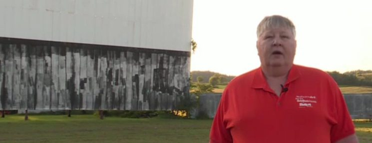Starlite 14 owner Bill Muth stands in front of the drive-in screen.