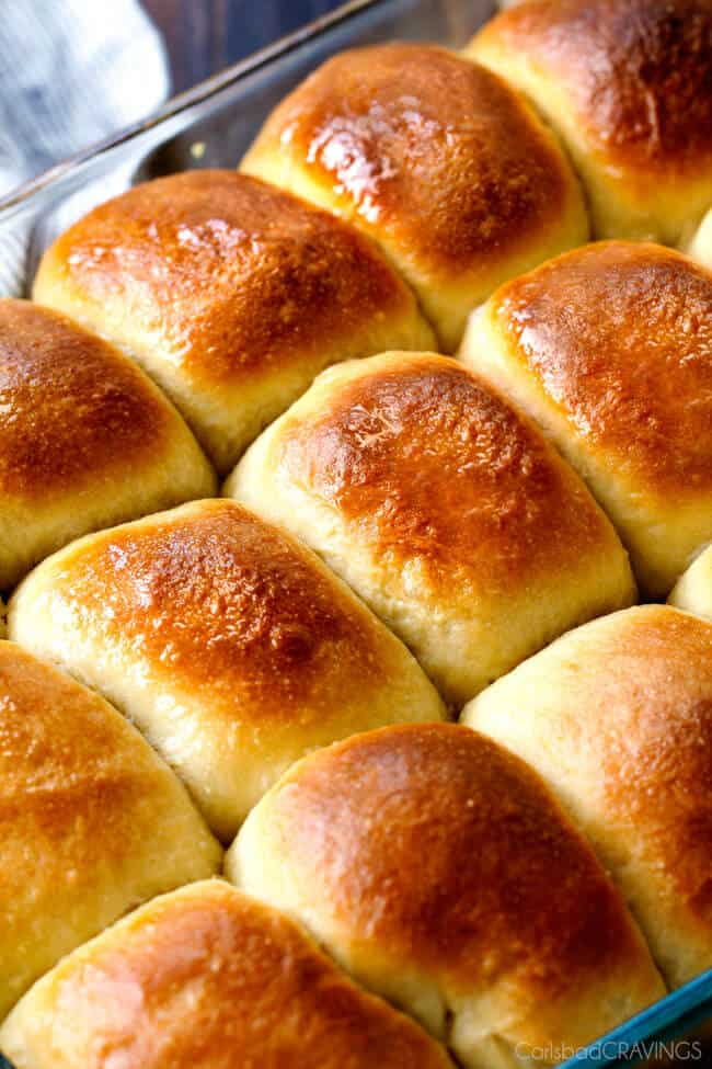 """Hawaiian Sweet Rolls Recipe   Carlsbad Cravings """"...sweet, buttery, Hawaiian Sweet Rolls are super soft and fluffy infused with pineapple juice and slathered in butter! My family LOVES these! perfect for sliders, potlucks and special occasions like Thanksgiving!"""""""