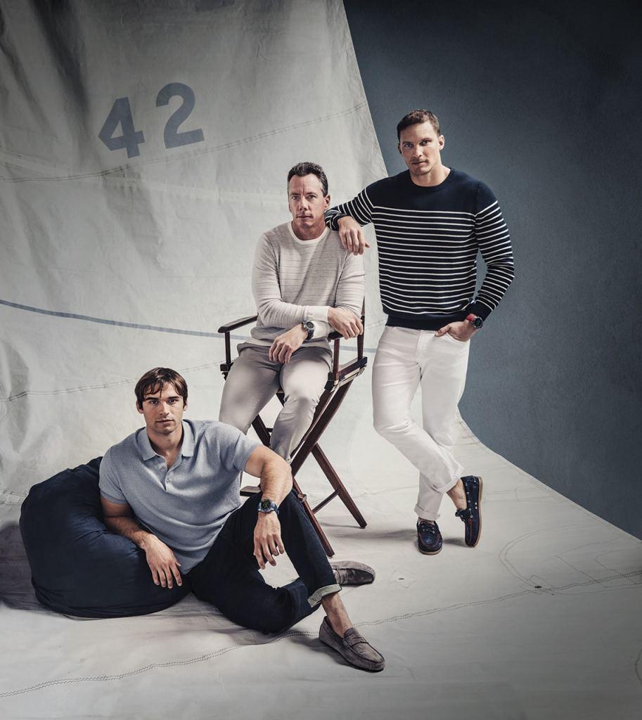 Tre menn som bærer Garmin Marq-klokker