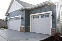 Carriage-style-garage-doors-in-almond-and-madison-window