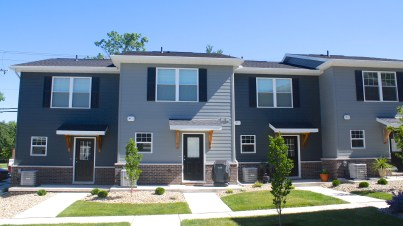 two story apartments in two tones of grey siding