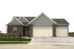 weathered-wood-roof-cedar-discovery-handsplit-shakes-in-scottish-thistle-green-mastic-scottish-thistle-green-siding-and-off-white-garage-door-normal-il