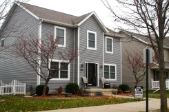 mastic-deep-granite-gray-siding-with-white-trim-siding-replacement-in-normal-il