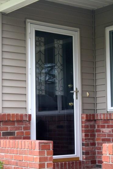 dark door with wire accents in two windows