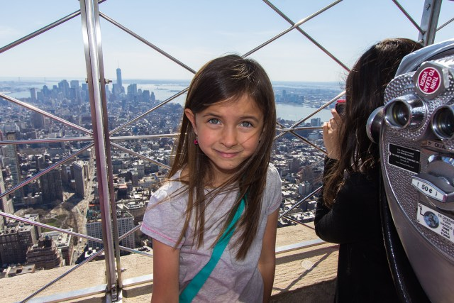 Girl on top of the Empire State Building in New York City Carltonaut's Travel Tips