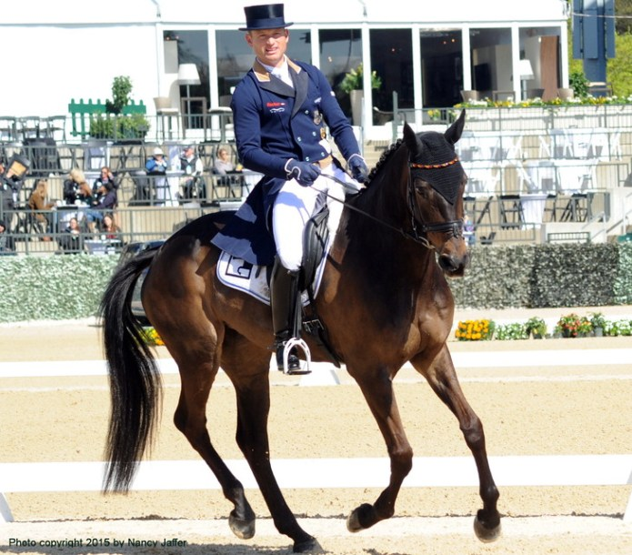 "Will Olympic eventing gold medalist Michael Jung someday be wearing a form-fitting shirt rather than ""museum clothes"" for the dressage phase?"