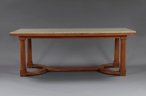 An elegant architectural walnut center or dining table with 'Swedish Green' marble top in the manner of Sir Ddwin Lutyens