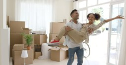 71837107 - ecstatic young couple celebrating their new home