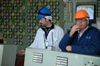A visitor and a career turbine engineer share a smoke in the Unit 2 control room at Chernobyl