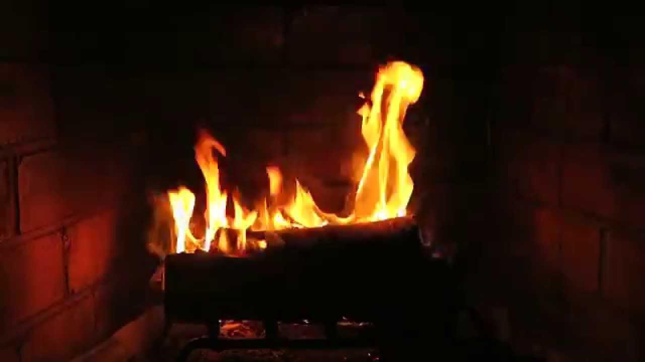 Fireplace With Christmas Music.Santa Sleeping Like A Yule Log At The Crackling Christmas