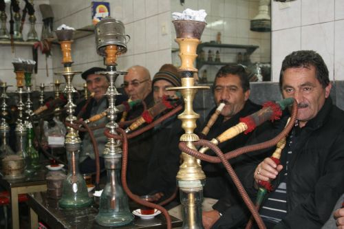 Locals smoking qalyans, water pipes, in the bazaar of Tabriz