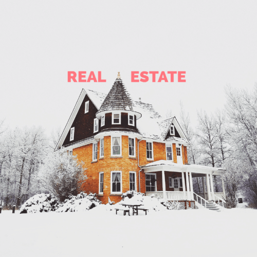 photo of large colonial style home in snow representing real estate in real estate in banff, canmore, bow valley