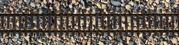 train tracks on rocks