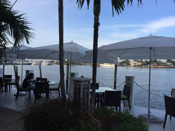 Dining on the dock at The Pillars Hotel
