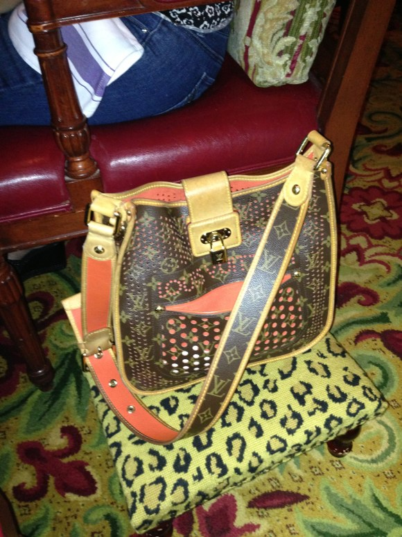 Louis Vuitton Bag on Stool at Mercato Italiano Restaurant - Four Seasons Hotel