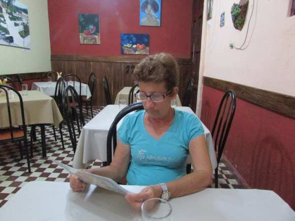 """My aunt choosing her food from the menu at """"1900's Restaurant"""""""