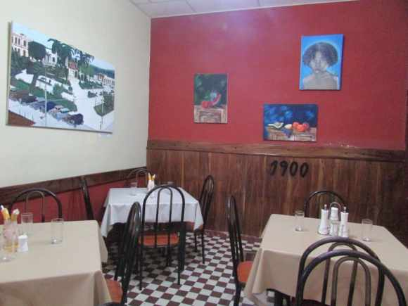 "1990's Restaurant"" in Placetas. The walls are decorated with some paintings by local artists"