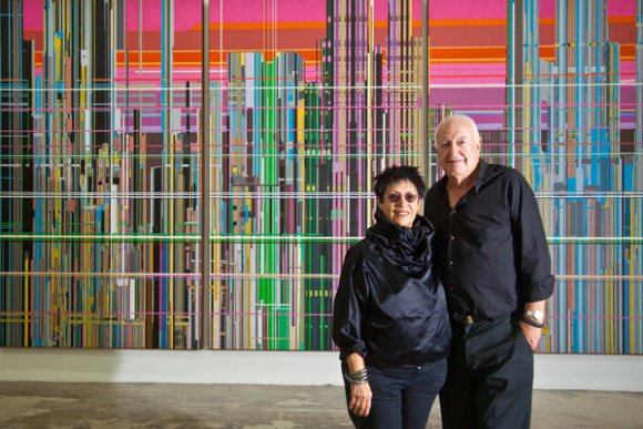 "Mera and Don Rubell at their museum in Miami. Behind them is ""Liberation No. 1,"" by Liu Wei, part of a new exhibition, ""28 Chinese (Image: HiddenGarments),"""