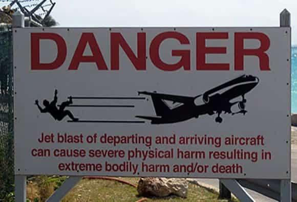 Warning Signs at Maho Beach outside of Princess Juliana airport St. Martin