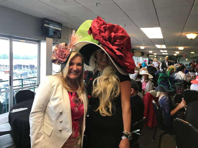 Comparing our Kentucky Derby hats at the 4th Floor Millionaire's Row