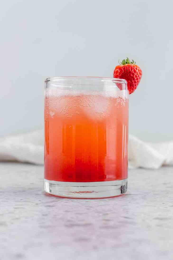 A glass of homemade strawberry basil soda.