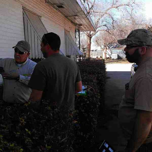 Employees (from left) Jimmy Ridgeway, Travis Ridgeway, and Matt Smith work at splicing a customer's house into the new fiber network.