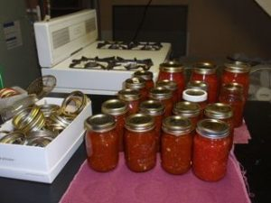 End of the day - 14 pints of salsa and 3 quarts of tomatoes.