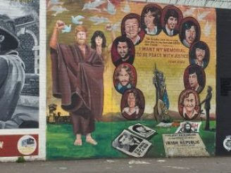 "The republican prisoners commemorated in this mural sought prisoner of war status. Rather than wear prison garb, they opted for blankets; their action became known as ""the blanket protest."" The prisoners also initiated a hunger strike. Some died before the protest ended."