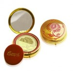 Besame face powder in a compact