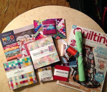 Some of the free SWAG I got at QuiltCon2015