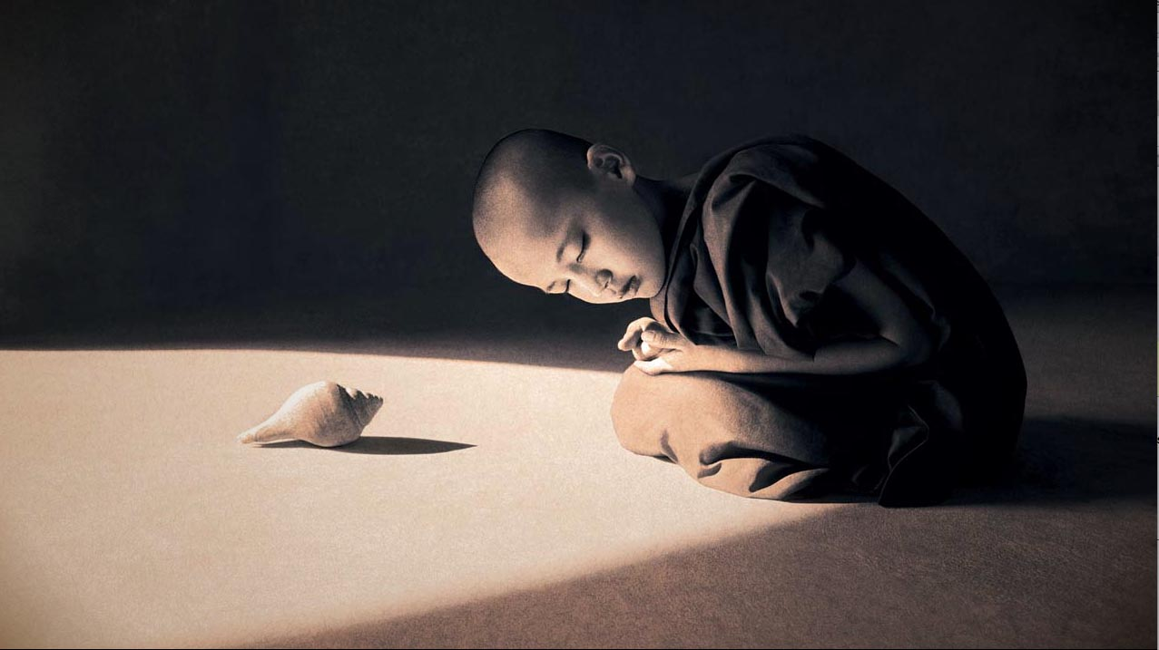 child budhist with shell