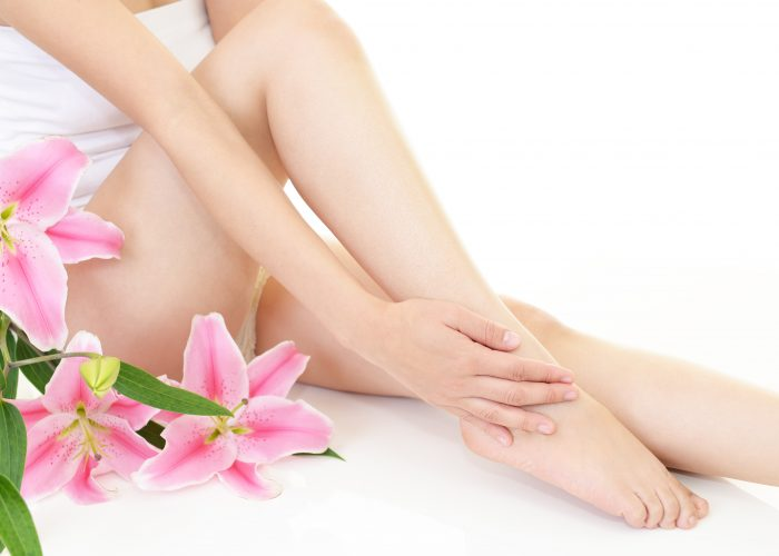 Womens Smooth Legs with a white background and flowers