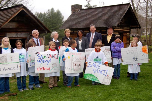 Elected officials and junior historians gather at a Save the Vance Birthplace rally on April 5, 2013. Under the latest state budget proposal, no state historic site would be closed. Photo courtesy of Vance Birthplace.