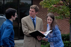 Appalachian State University Student Body President Jonathan Meisner confers with Vice President Adam Ezell (left) and Public Affairs Director Sarah Dickson (right) after a hearing and vote Tuesday by the N.C. State Board of Elections. Kirk Ross/Carolina Public Press