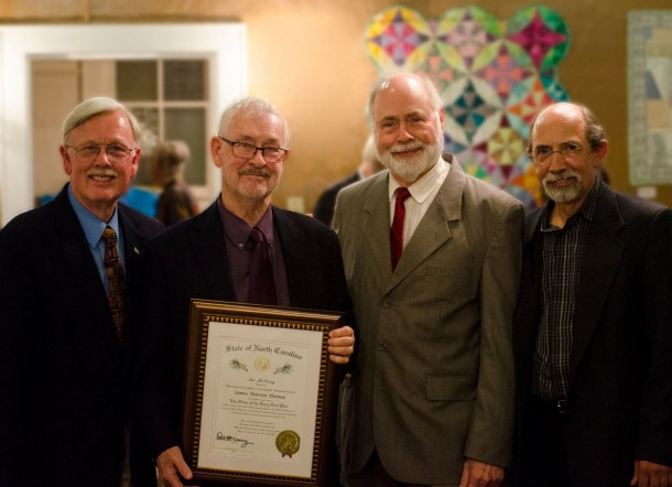 Jim Thomas (second from left), recipient of the Order of the Long Leaf Pine, poses with former colleagues from Mars Hill University: Neil St. Clair, professor of theatre arts (left), C. Robert Jones, professor of theatre arts emeritus, and Bill Gregg, professor of theatre arts. Photo courtesy of Mars Hill University.