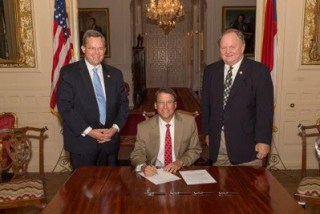 Rep. Nathan Ramsay, Gov. Pat McCrory and Rep. Chuck McGrady pose during the signing of Senate Bill 574. Photo courtesy of the Office of the Governor.