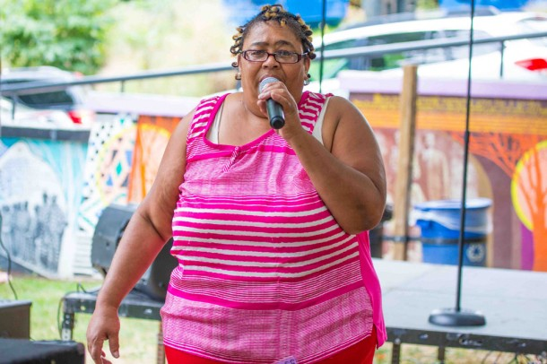 Bubbles Griffin, president of the Asheville community organization Just Folks, speaks to the crowd on Saturday. Alicia Funderburk/Carolina Public Press