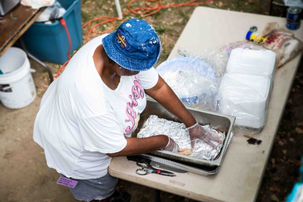 Members of Just Folks prepared a fish fry for participants of Saturday's  'Peace Rally,' held in downtown Asheville historic black business district known as 'The Block.' Alicia Funderburk/Carolina Public Press