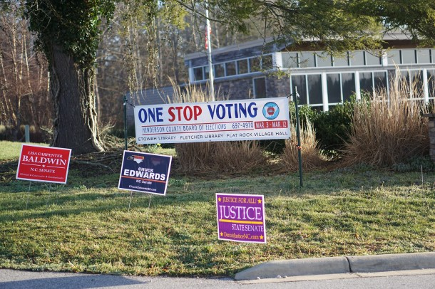 Signs sit outside the Etowah Library in Henderson County as voters arrive at the precinct to participate in the March 15, 2016, primary. Ari Sen / Carolina Public Press