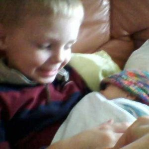 Chaise Boley, 4, holds his baby brother Addison in his arms at two weeks old in December 2010.