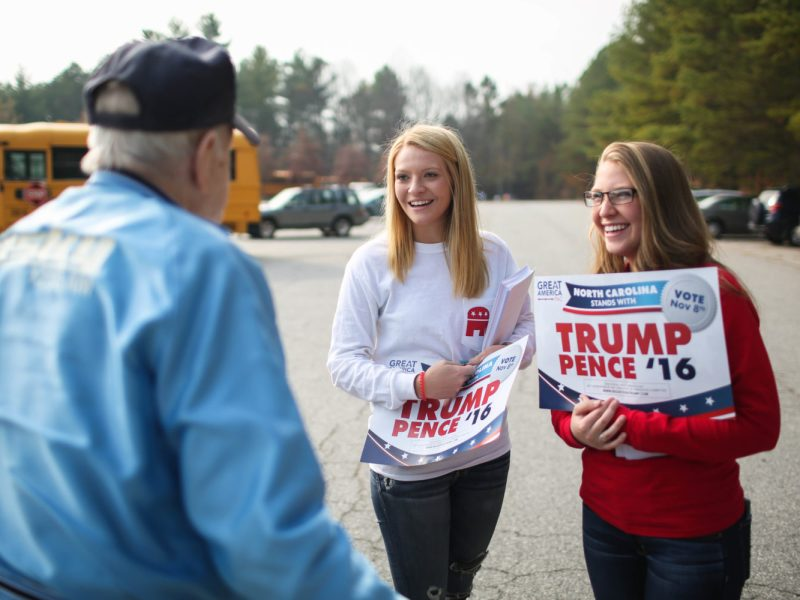 Trump supporters do some last minute campaigning just outside of the polling area at North Buncombe Elementary School on the afternoon of Tuesday, November 8, 2016.