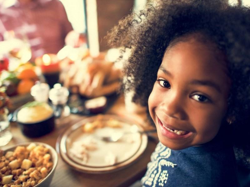 Stock image of smiling girl celebrating