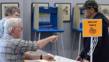 photo ID Nash County poll worker Jim Martin instructs Jose Negron as he prepares to vote in the 2020 primary election at the Braswell Memorial Library polling place in Rocky Mount on March 3, 2020. Calvin Adkins / Carolina Public Press