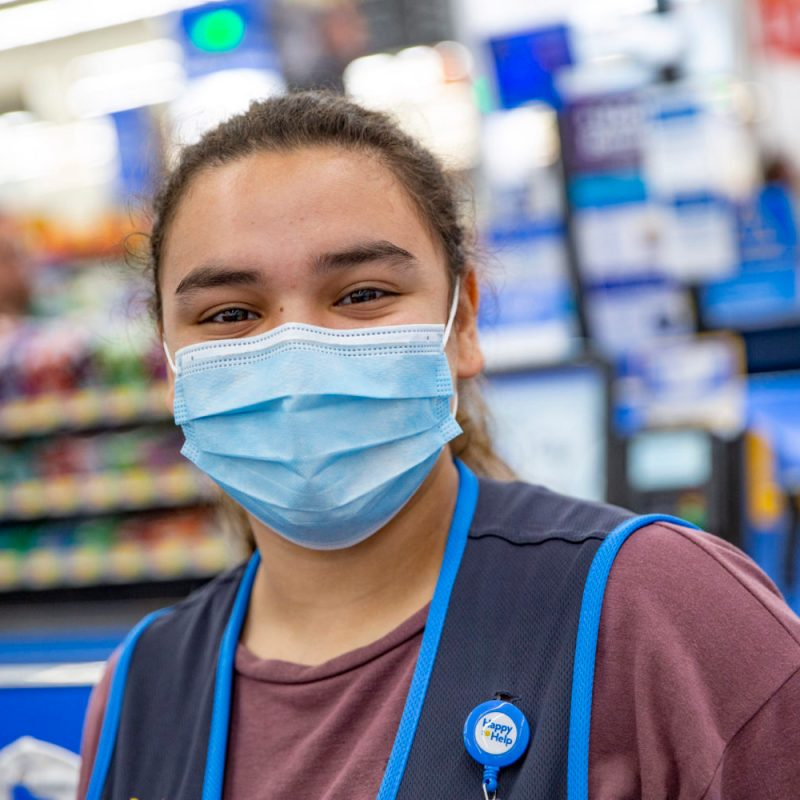 Grocery stores are taking preventative measures, both voluntary and required, during the coronavirus pandemic. Here a Walmart employee wears a mask. Photo courtesy of Walmart
