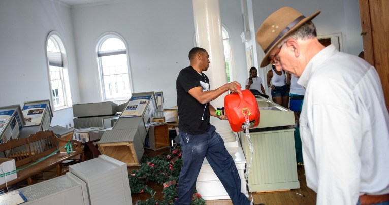 Charles Pittman walks through the interior of the historic Market House in Fayetteville on May 30, pouring the contents of a gas can onto the floor during protests after the death of George Floyd. Pittman has since been indicted in relation to the incident. Melissa Sue Gerrits / Carolina Public Press