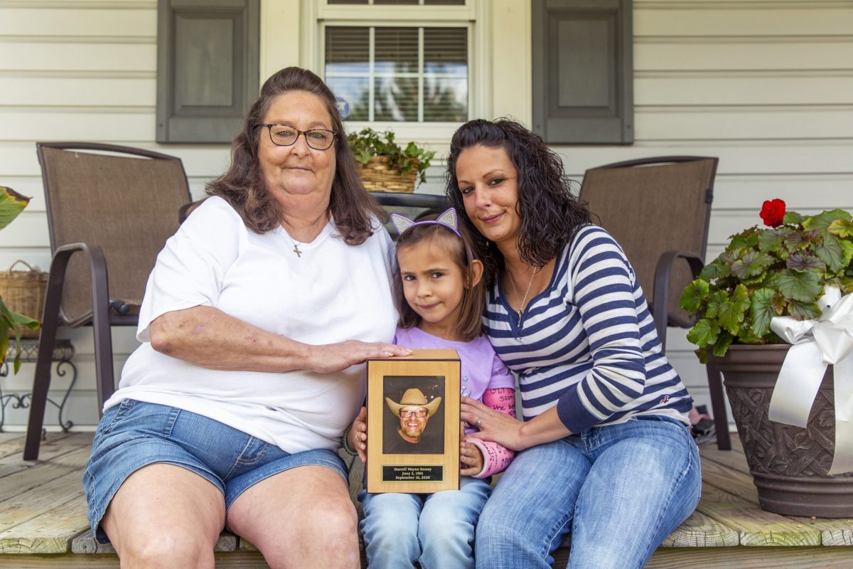 From left, Teresa, Kensley, and Kelli Kersey sit for a portrait outside their High Point home on Oct. 22, 2020, after an interview about Darrell Kersey, their husband, grandfather and father, who died of complications from COVID-19 which he tested positive for while incarcerated in the Durham County jail. Casey Toth / News & Observer
