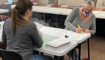 Buncombe County election workers prepare mail ballots for review by the county's elections board. Victoria Loe Hicks / Carolina Public Press