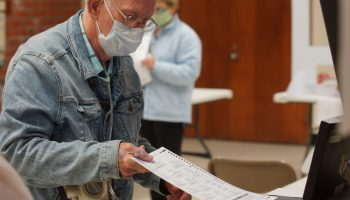 Ed Kilby places his ballot in the box on election day.